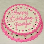 pink and black round girls birthday cake