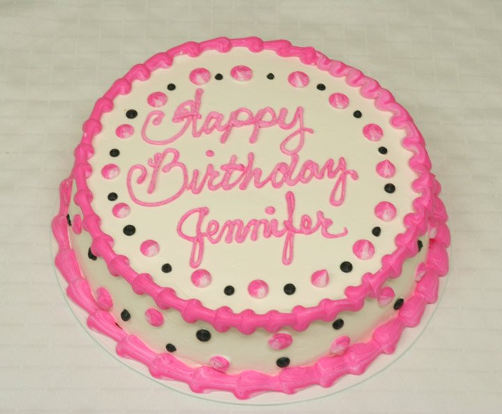 A Popular Girls Birthday Cake With Pink With Black Dots