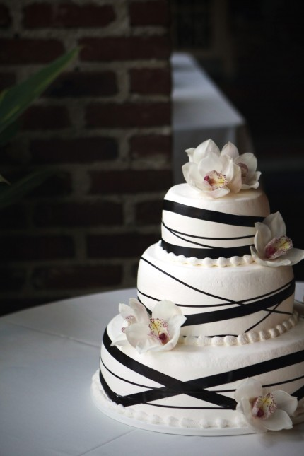 black ribbon wedding cake with flowers