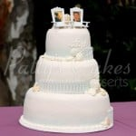 beach-wedding-cake-white-fence-photos