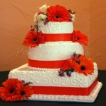 wedding cake orange ribbon flowers square round