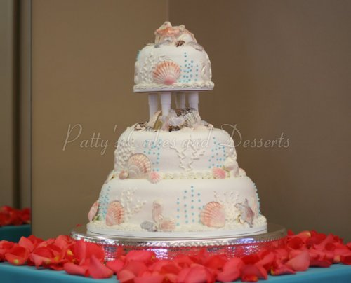 Beach themed wedding cakes archives pattys cakes and desserts wedding cake sea shell beach orange flowers junglespirit Choice Image