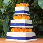 blue-ribbon-orange-flowers-white-wedding-cake