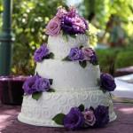 wedding cake white purple flowers round