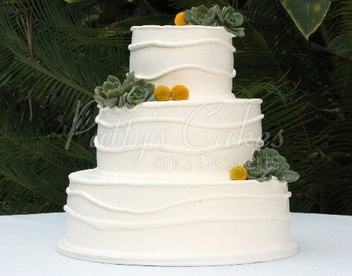 wedding cake white succulents green modern