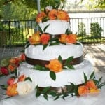 wedding-cake-brown-ribbon-orange-flowers