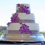 wedding-cake-stand-purple-flowers-outdoors