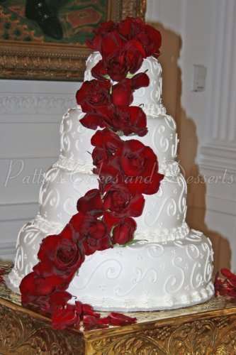 round wedding cakes with red roses beautiful 4 tier wedding cakes 19339