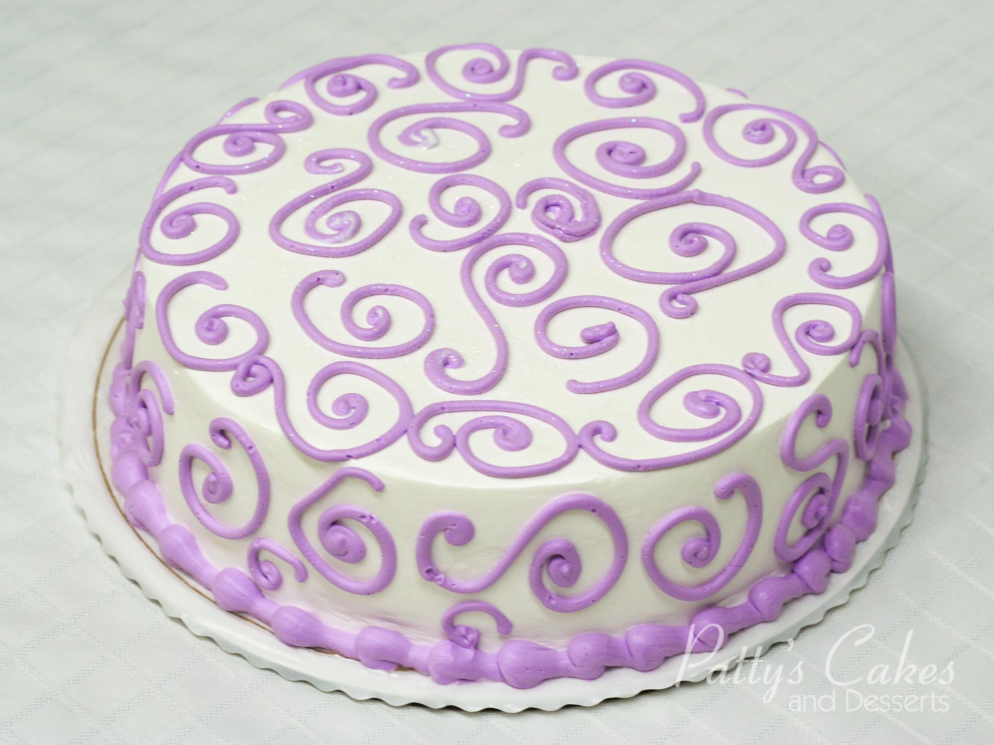 white-purple-round-cake
