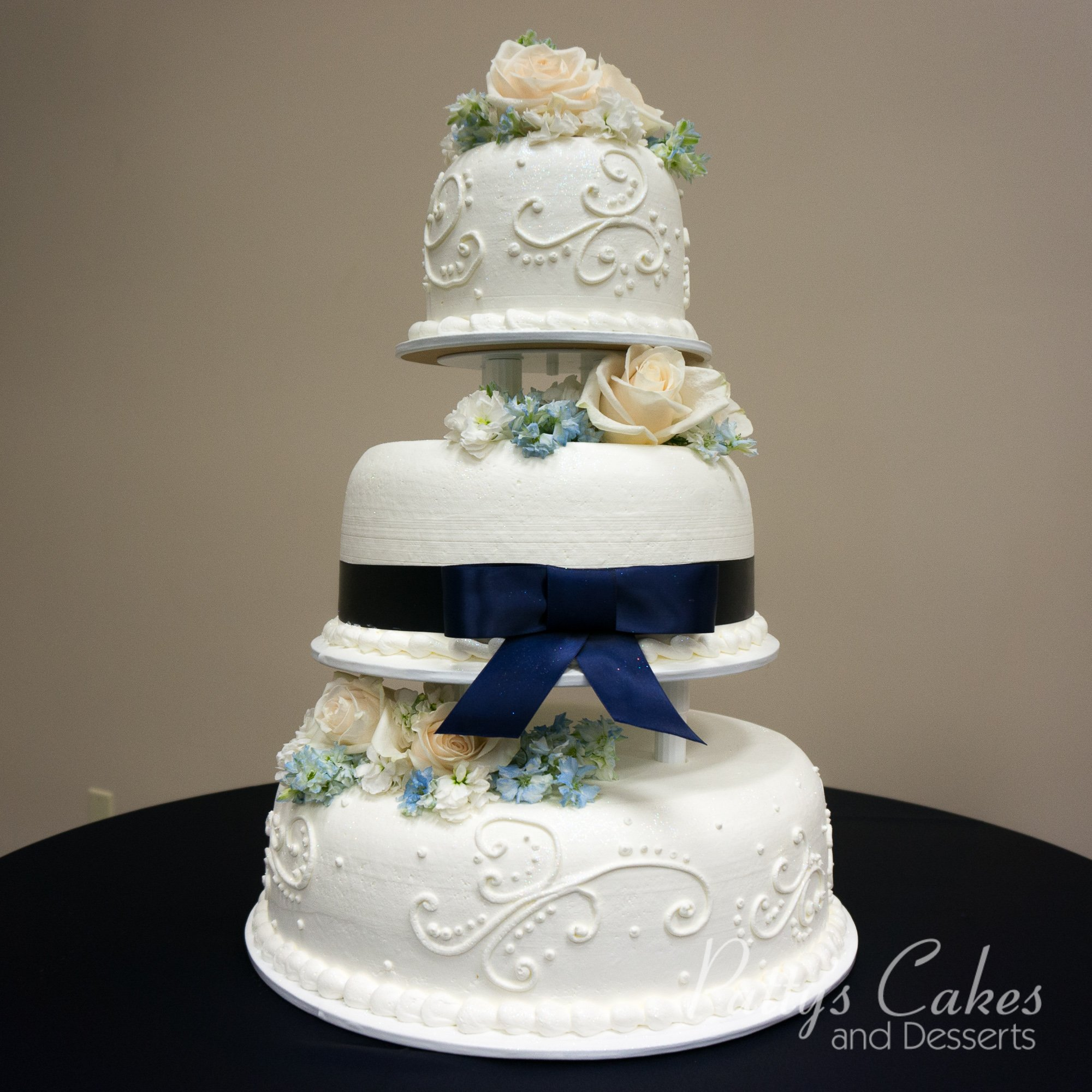photo of a 3 tier wedding cake blue white patty 39 s cakes and desserts. Black Bedroom Furniture Sets. Home Design Ideas