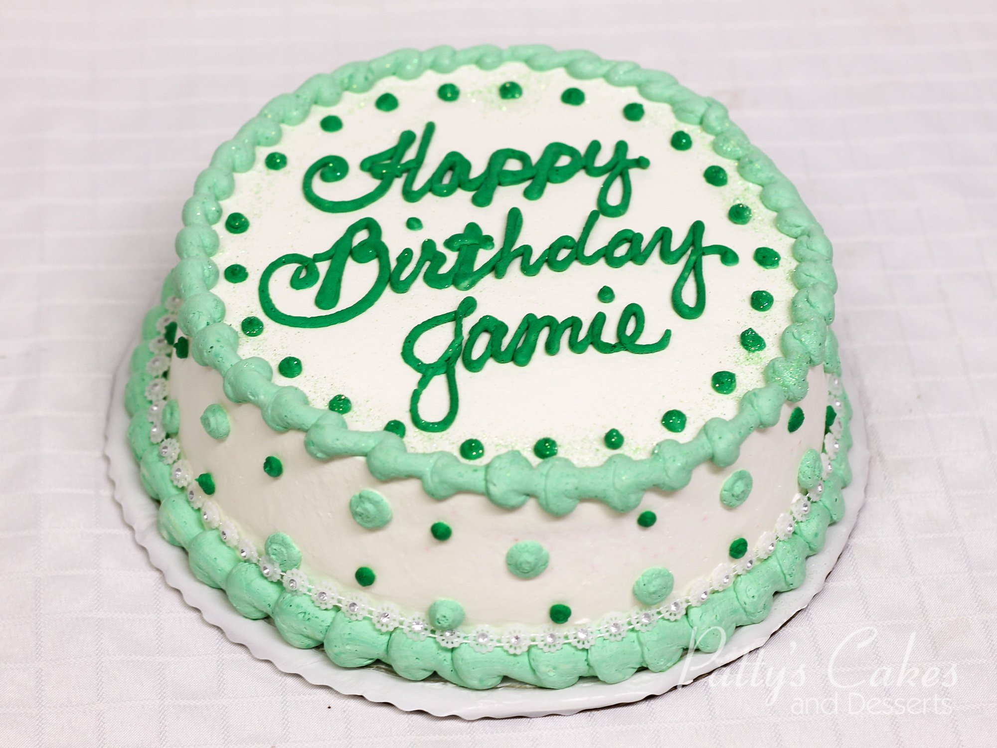 Photo Of A Birthday Cake White Green Round Pattys Cakes And Desserts