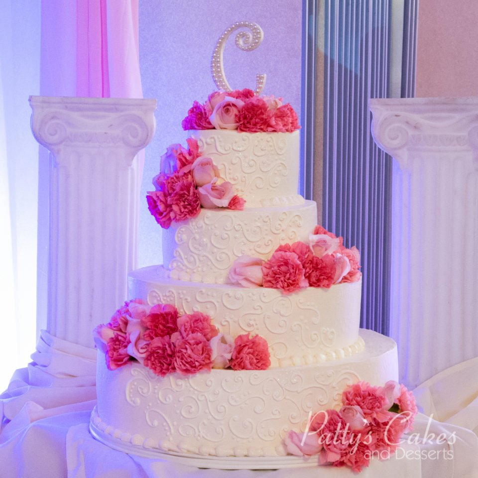 Photo of a pink red flowers wedding cake - Patty\'s Cakes and Desserts