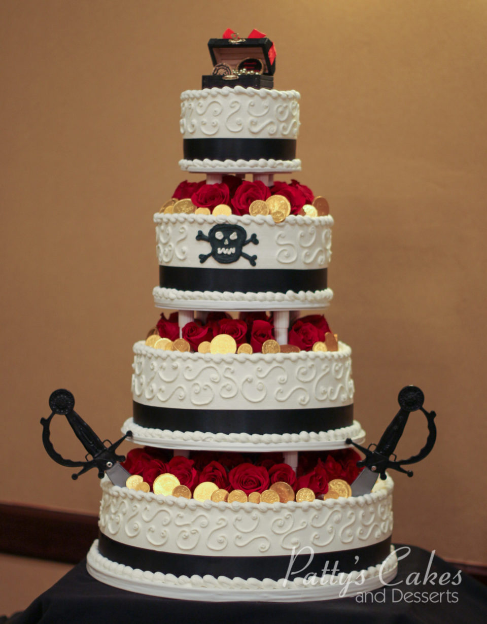 Photo of a pirate theme tiered birthday cake Pattys Cakes and