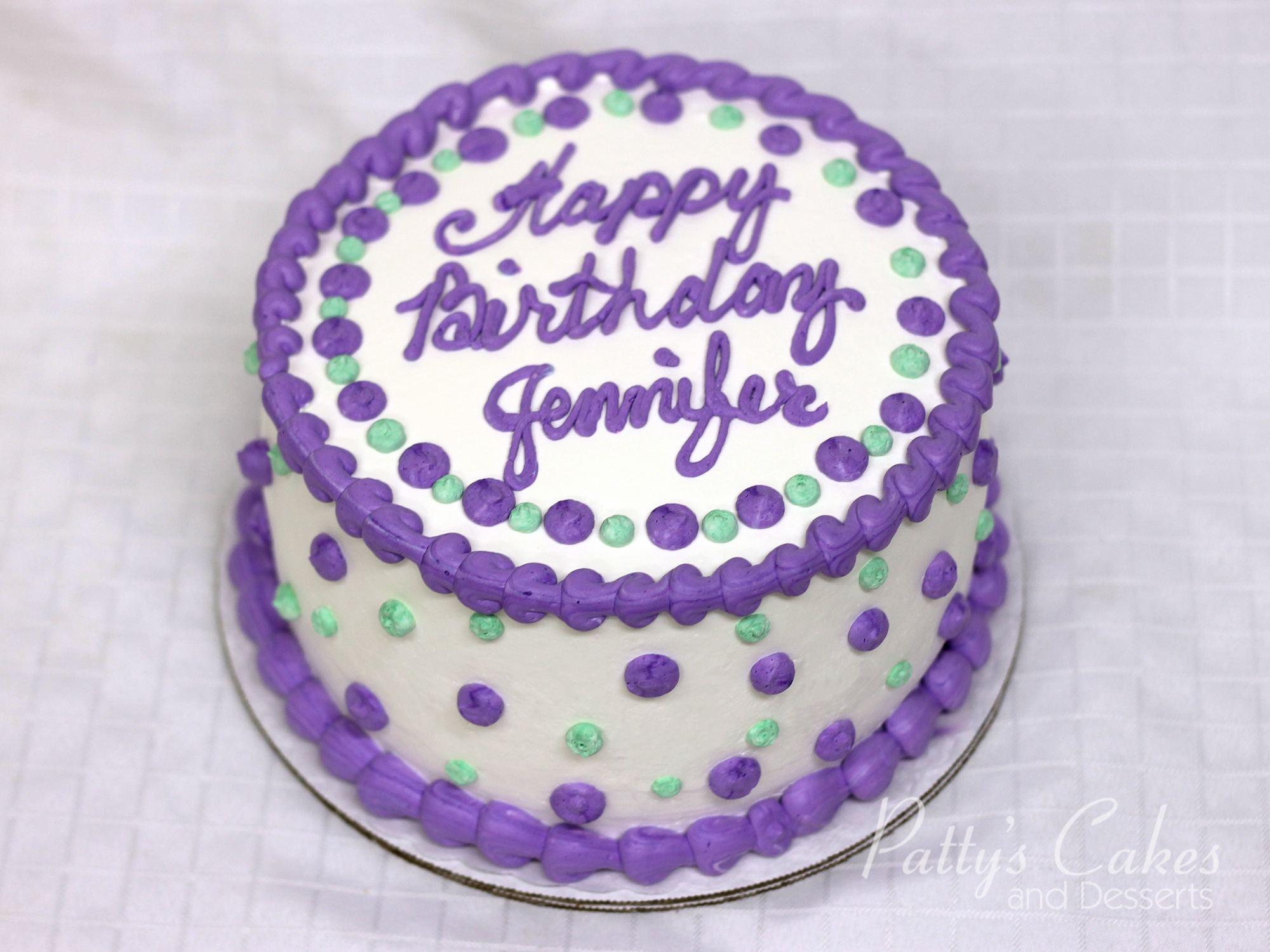 Photo Of A Purple Double Layer Birthday Cake Pattys Cakes And