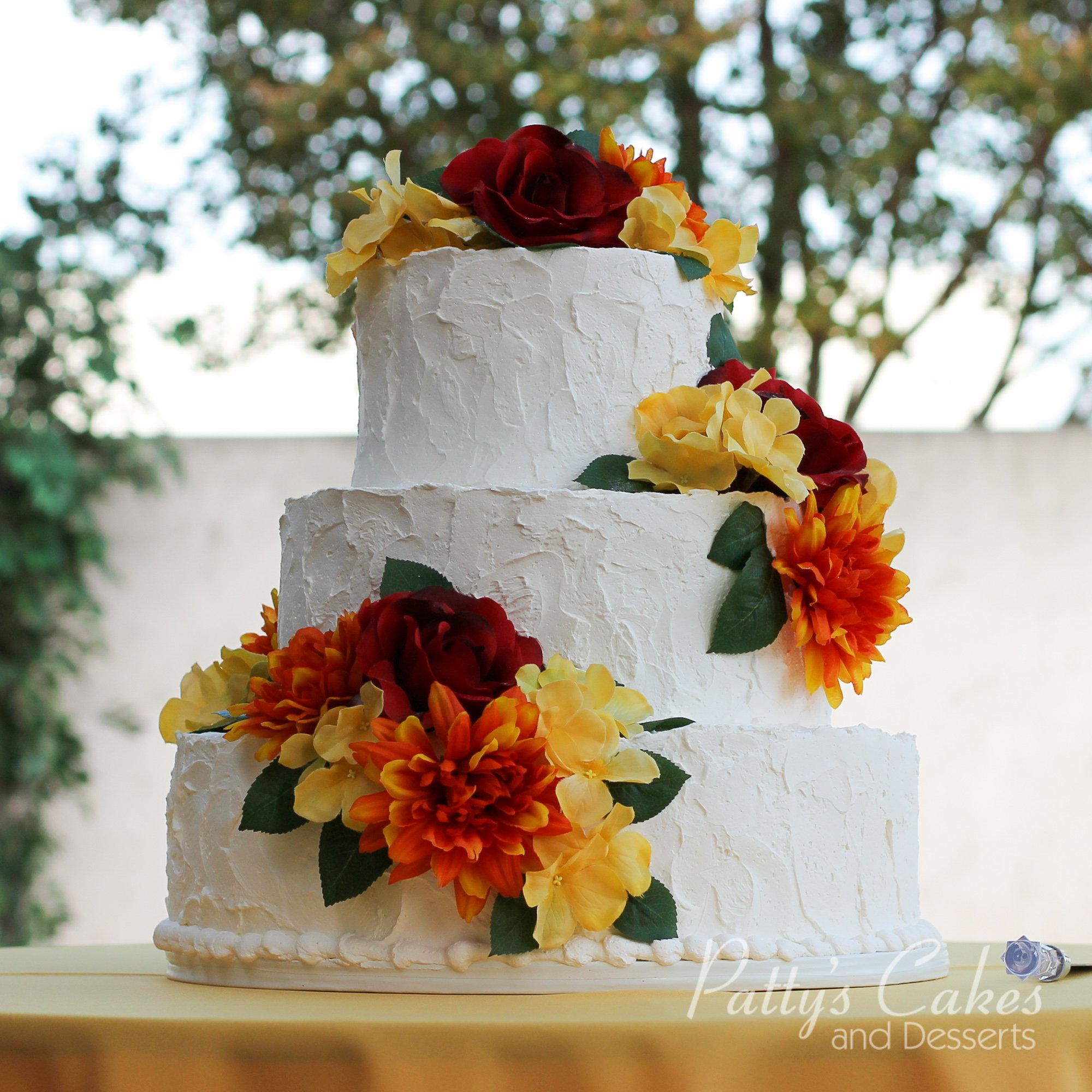 Photo Of A Rustic Wedding Cake Colorful Flowers Patty S