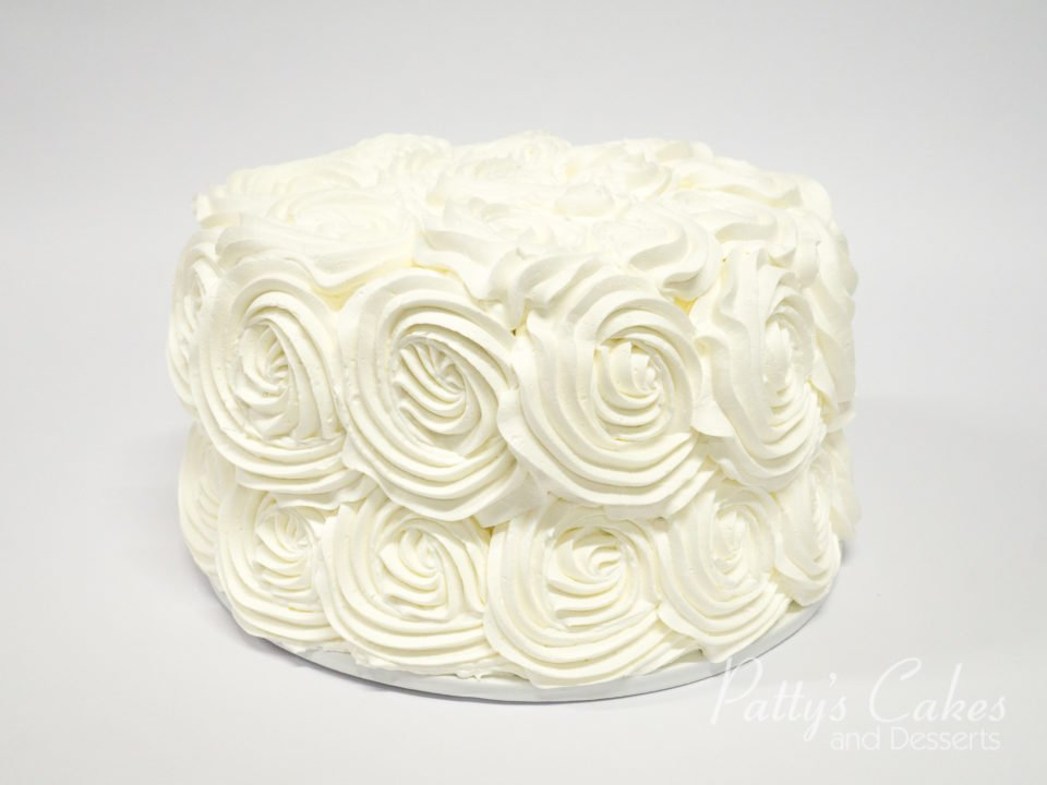 Photo of a small simple white rosette cake Pattys Cakes and Desserts