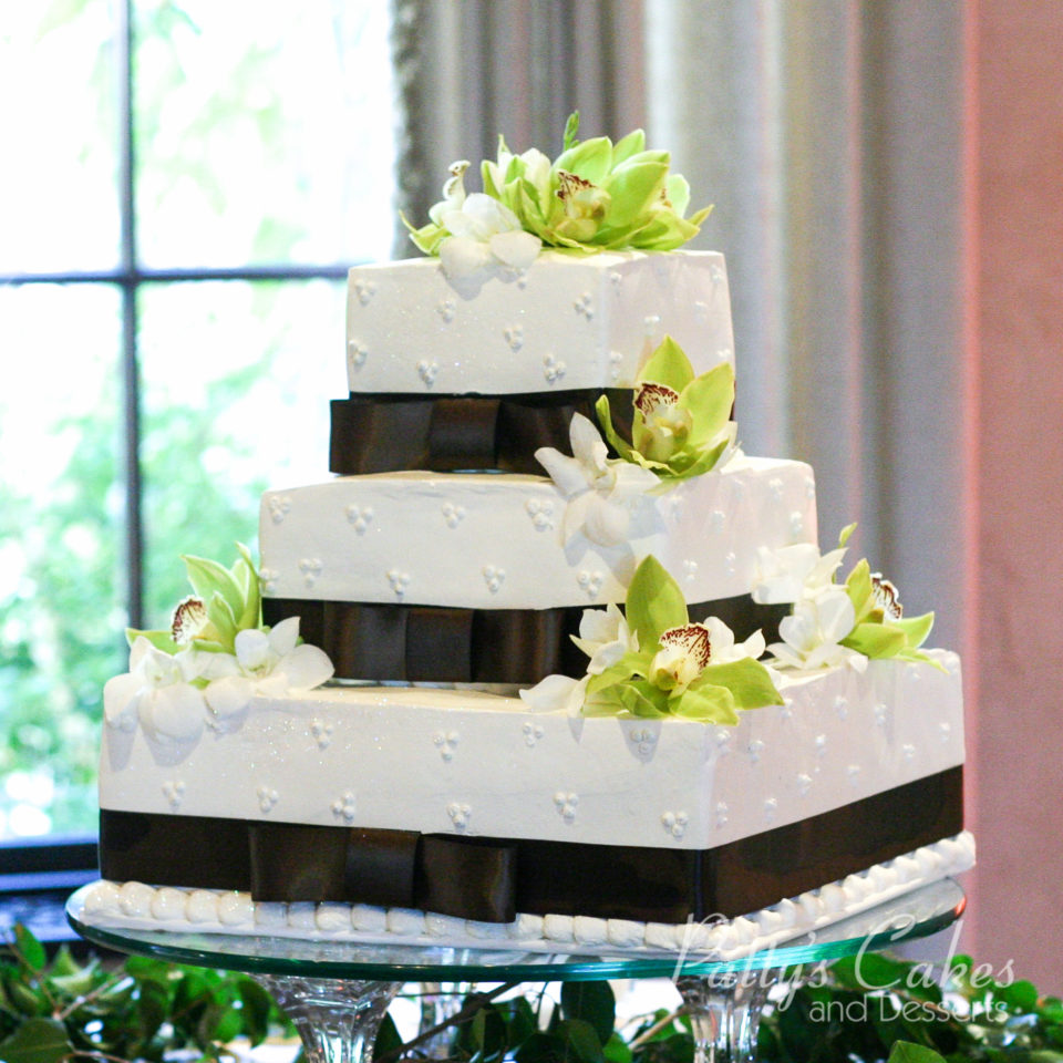 square wedding cakes with ribbon and flowers photo of a square wedding cake brown ribbon green flowers 20429