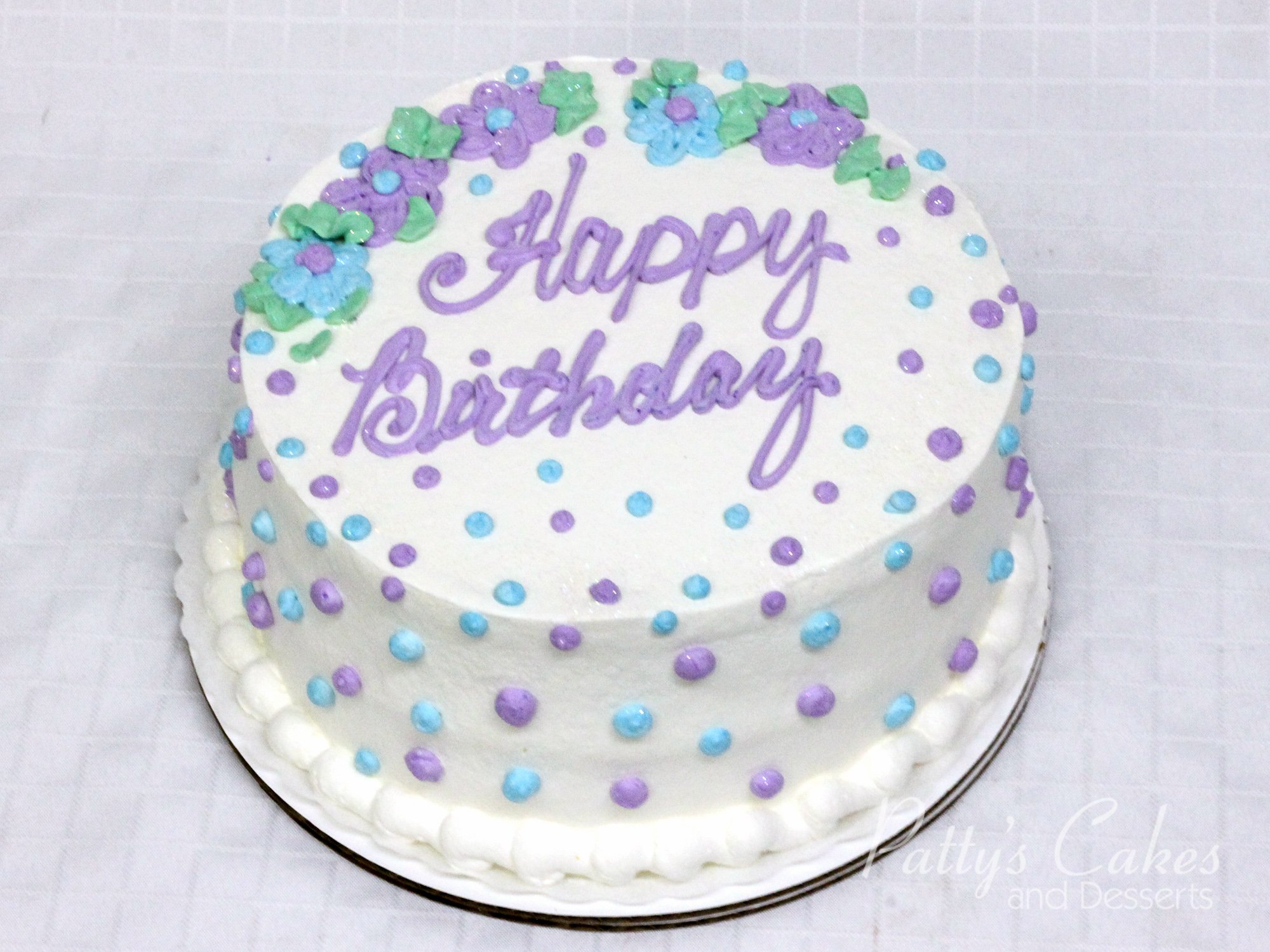 Photo of a violet blue green white birthday cake Pattys Cakes