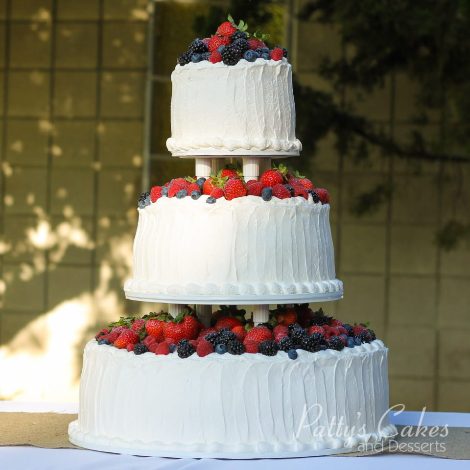 Photo Of A Wedding Cake Berries Fresh Fruit Strawberries White Red - Fresh Fruit Wedding Cake