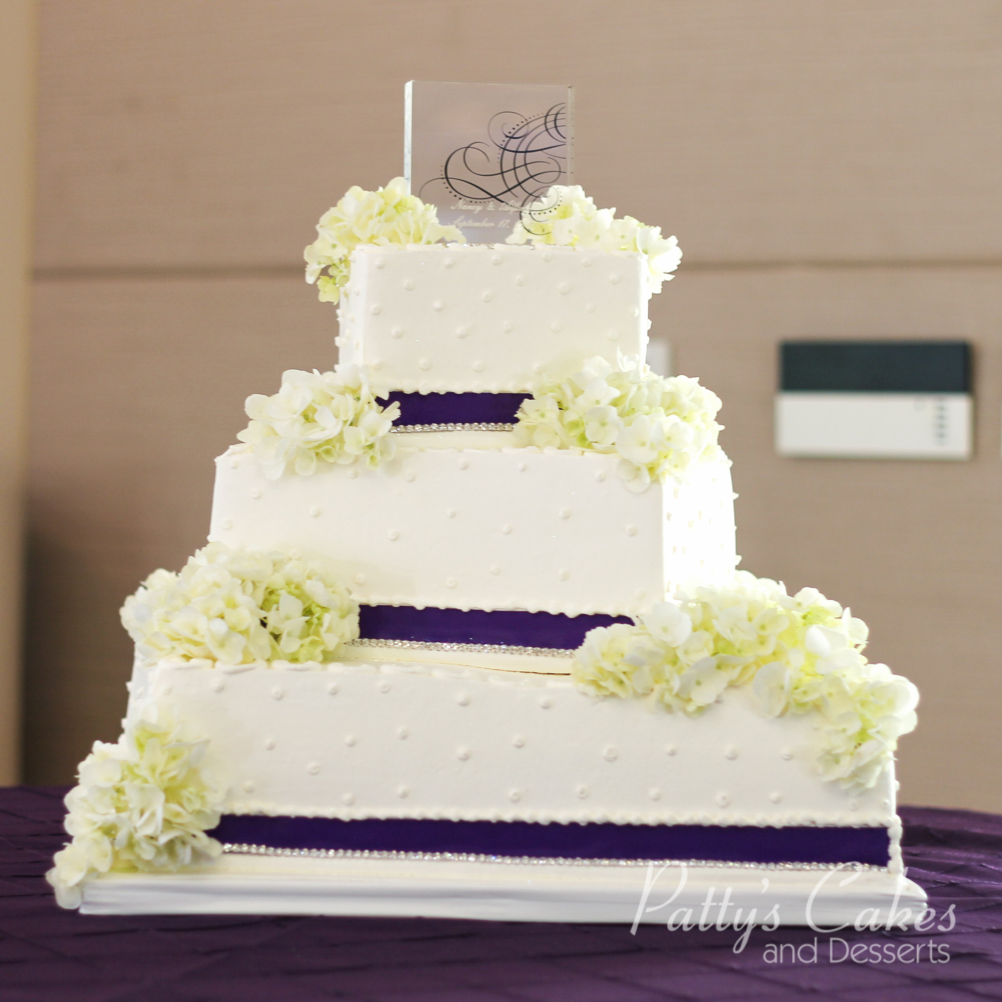 square wedding cake with purple ribbon photo of a wedding cake square purple ribbon flowers 20438