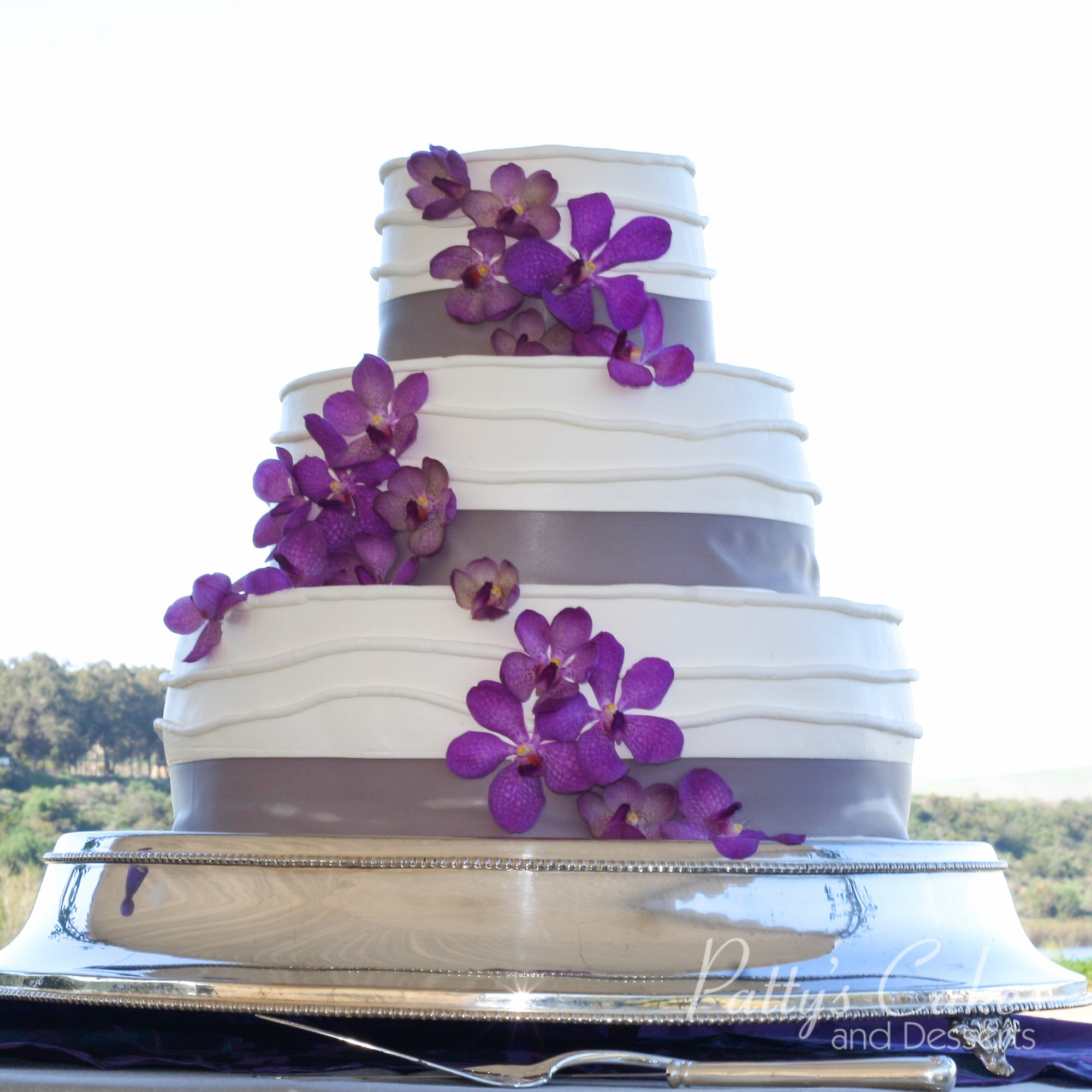 Outdoor Wedding Cake Ideas: Photo Of A Wedding Cake Stand Purple Flowers Outdoors