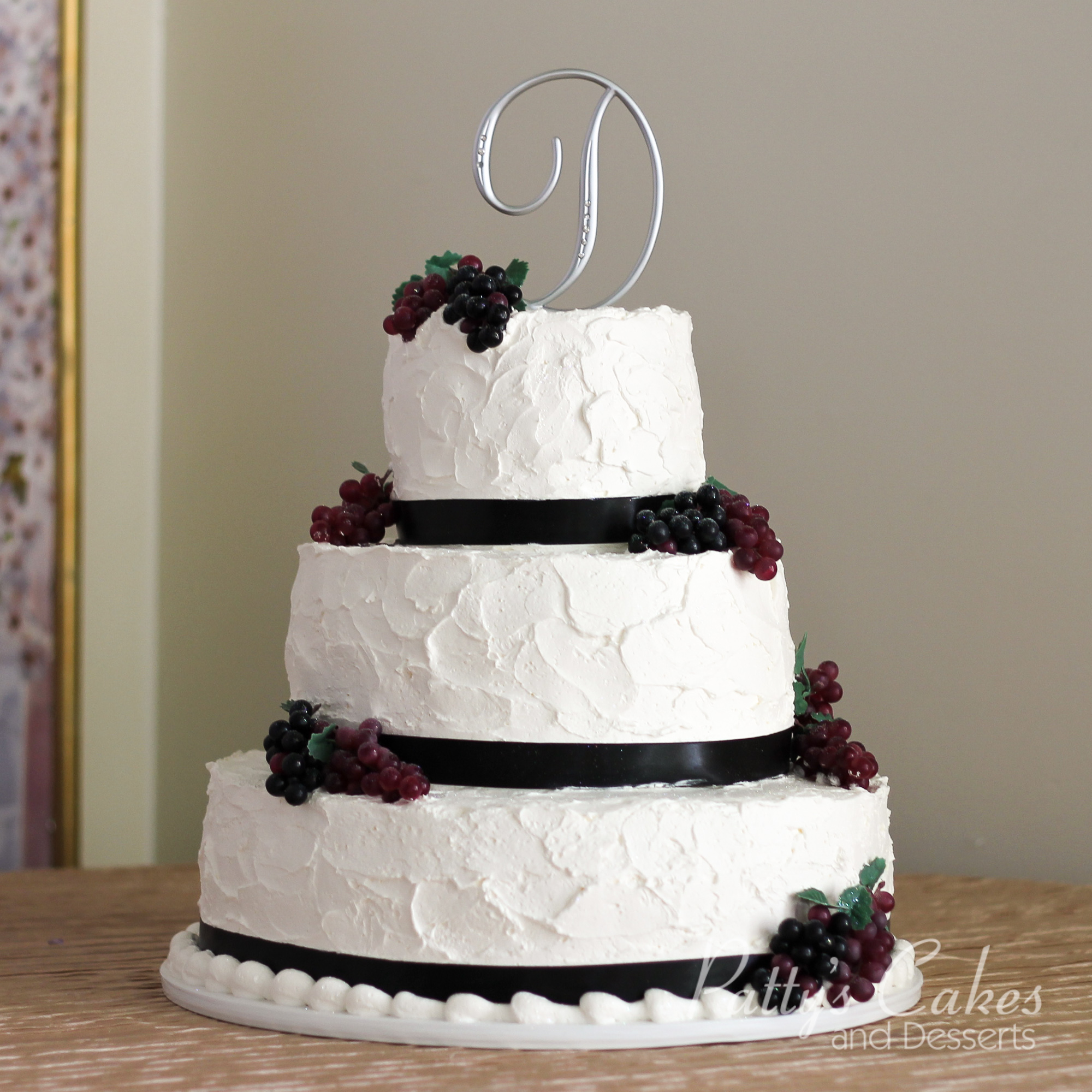black and white wedding cake photos photo of a wedding cake textured grapes ribbon black white 11845