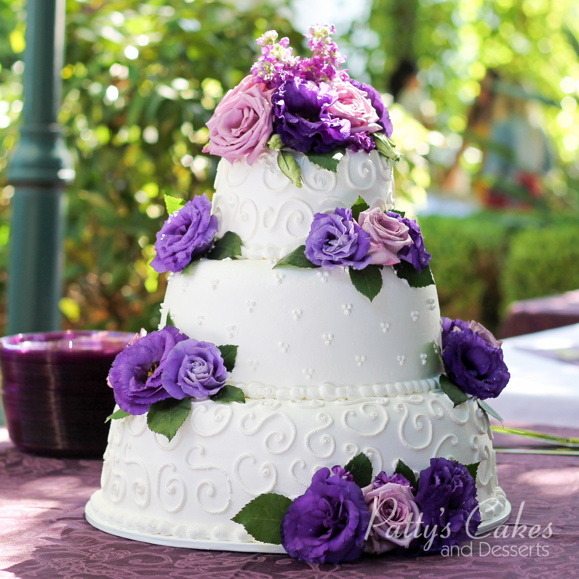 wedding cake with purple flowers photo of a wedding cake white purple flowers patty 26946