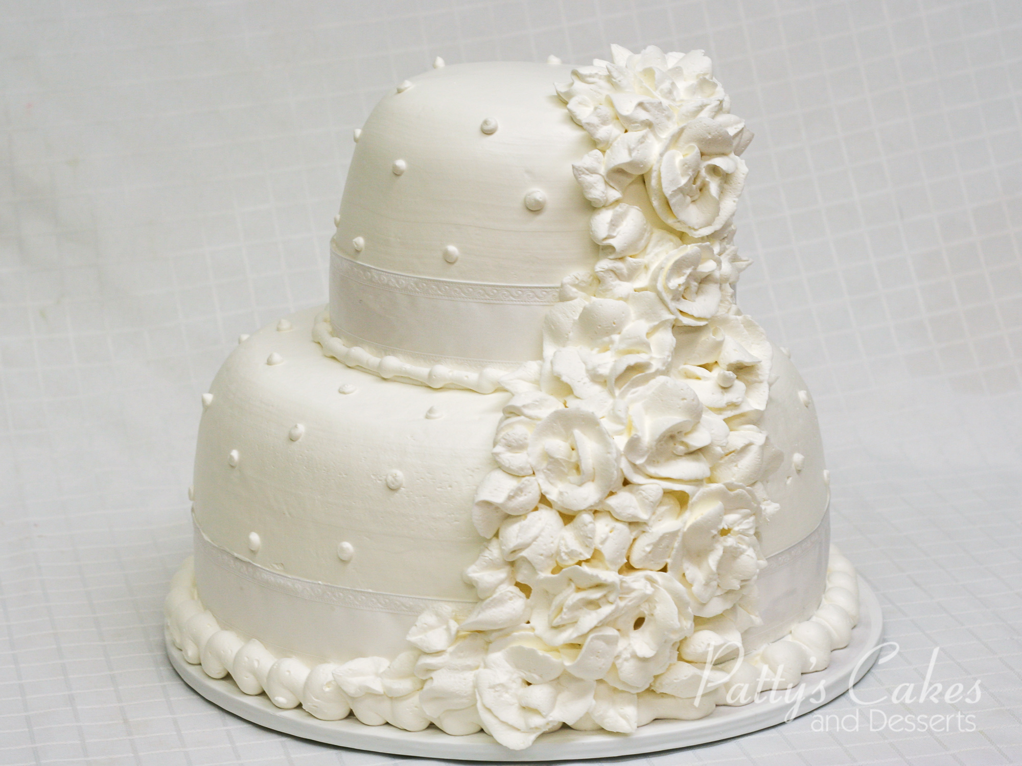 Photo of a white flowers anniversary cake - Patty\'s Cakes and Desserts