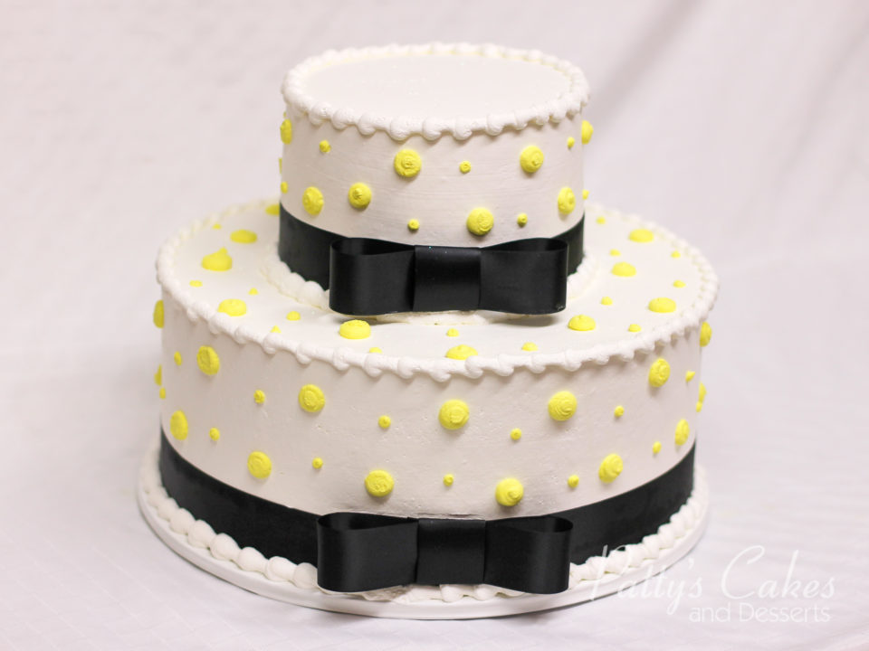 Photo Of A White Yellow Black Ribbon 2 Tier Cake Pattys Cakes And
