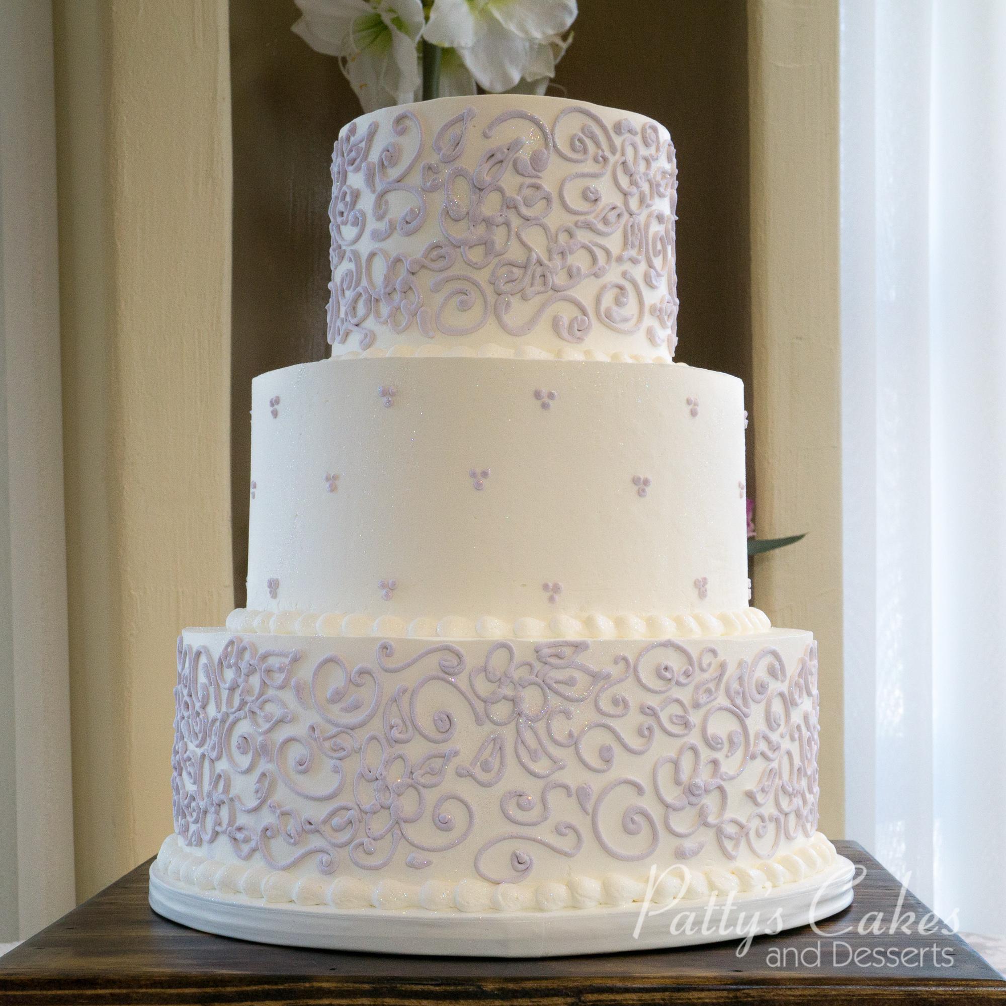 of a white purple wedding cake flowers Patty s