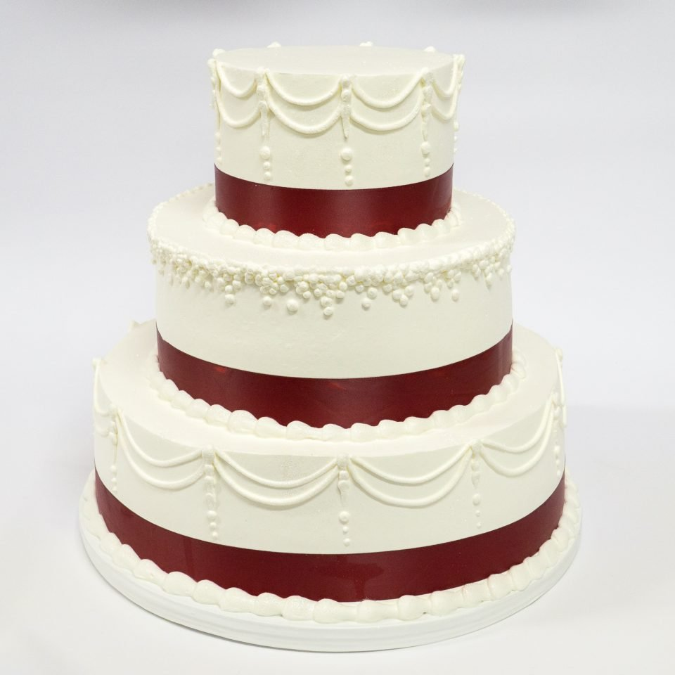 Photo of a white burgundy wedding cake simple - Patty's